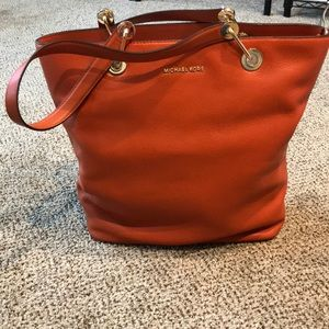 4f9a9979c533 Michael Kors. Michael Kors Raven Large North South Top Zip Tote